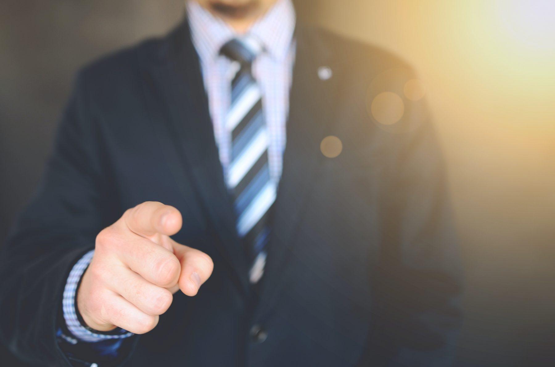 leader vs boss pointing a finger